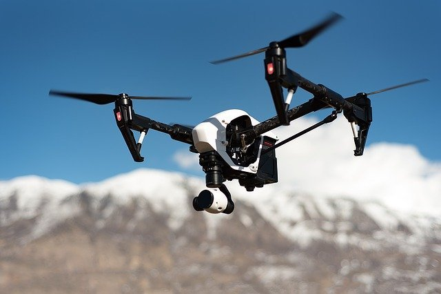 an image of a drone camera flying over mountains